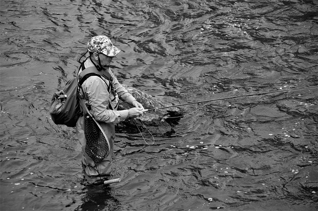 fly fisherman with waders