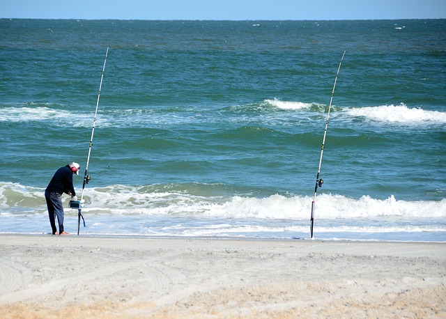 surf casting beach fisherman