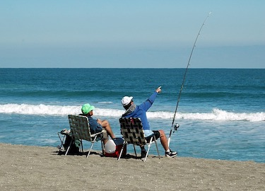surf fishing from a beach